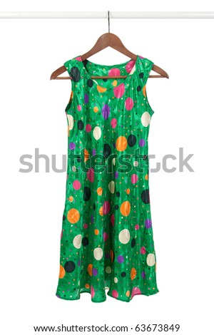 Bright green funky dress on a wooden hanger, isolated on white. - stock photo