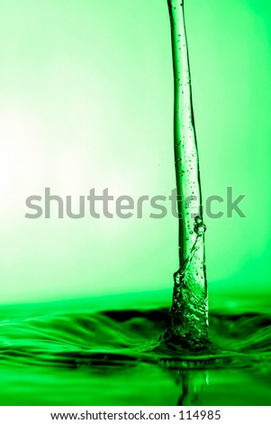 bright green liquid flowing - stock photo