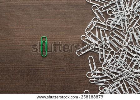 bright green paper clip unique idea concept - stock photo