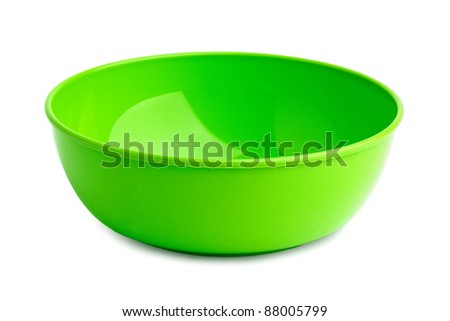 Bright green plastic plate on a white background - stock photo