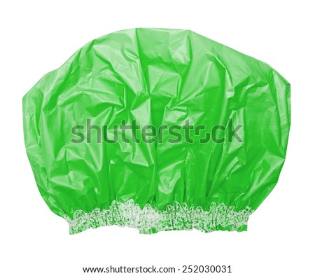 Bright green shower cap on the white - stock photo