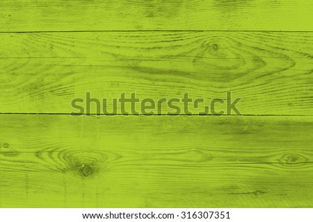 Bright green wood structure as a background texture. - stock photo