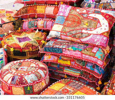 Bright hand made pillows selling on a local eastern market - stock photo