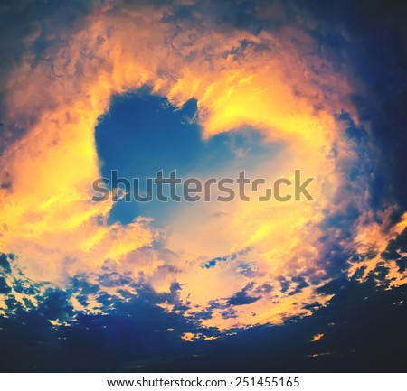 Bright Heaven in a sunset, shape of Heart, blue sky, background  - stock photo