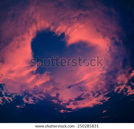 Bright Heaven in a Violet Sunset, Shape of Heart, dark blue sky, background - stock photo