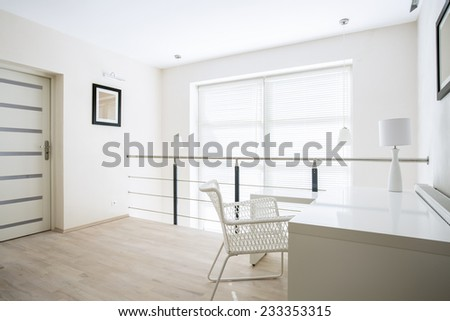Bright home office placed on mezzanine floor - stock photo