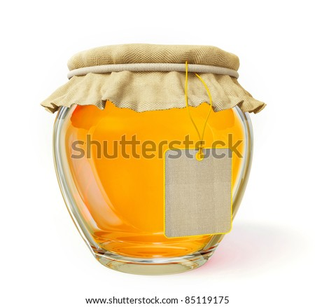 bright honey in a glass jar isolated on white