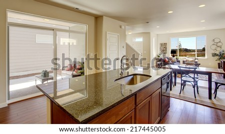 Bright house interior. Kitchen room with kitchen island and walkout deck