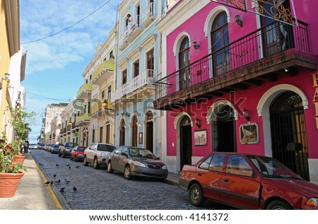 Bright houses line a cobblestone street in Old San Juan, Puerto Rico