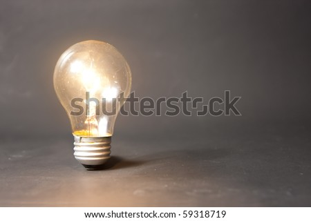 bright idea concept with light bulb - stock photo