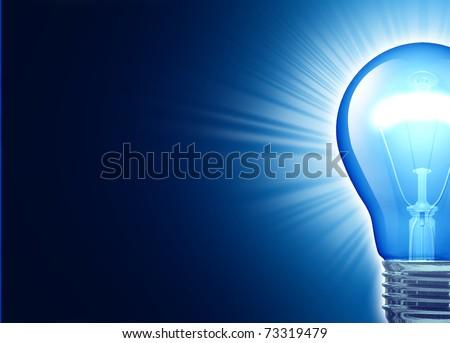 Bright idea represented by a glowing blue lightbulb symbol of creativity. - stock photo
