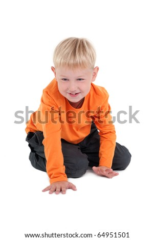 Bright image of little boy crawling on the floor. - stock photo