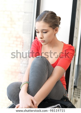 bright indoors picture of calm teenage girl - stock photo