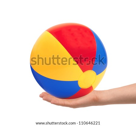 bright inflatable ball in hand isolated on white background - stock photo