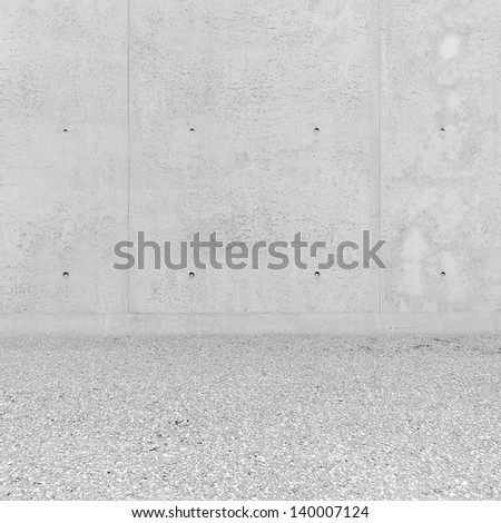 Bright interior room with concrete plates and asphalt floor