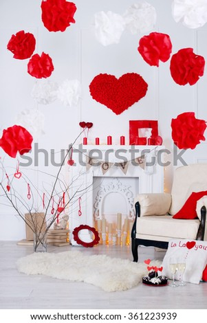 Bright interior with fireplace decorated with Valentines Day - stock photo