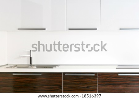 Bright kitchen counter top with wooden details - stock photo