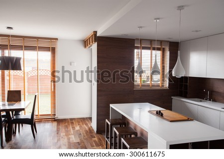 Bright kitchen with dinning room in apartment - stock photo