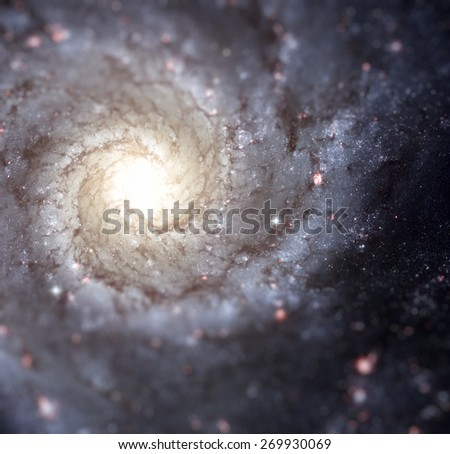 Bright knots of glowing gas light up the arms of spiral galaxy M74, indicating a rich environment of star formation. Cleaned and retouched image, original by ESA-Hubble - stock photo