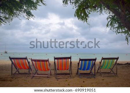 Bright light in sea and sand beach chairs,holiday concepts