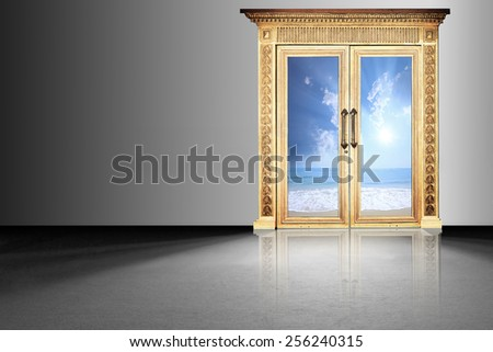 Bright light shines through an glass door in a dark room  - stock photo
