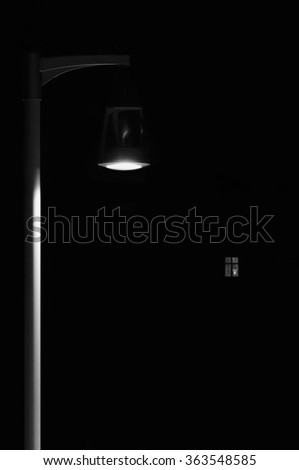 Bright Lit Outdoor Lantern Lamp Pole Post, Lonely Concept Solitude Metaphor, Illuminated Window Light, Vertical Deserted Night Park Scene Closeup, Black Isolated Copy Space Background - stock photo