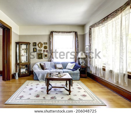 Bright living room interior with antique furniture in old american house - stock photo