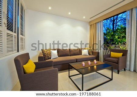 Bright Living room with grey sofa armchair combination - stock photo