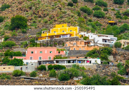 Bright local houses on Alicudi Island, Aeolian Islands, Sicily, Italy. - stock photo