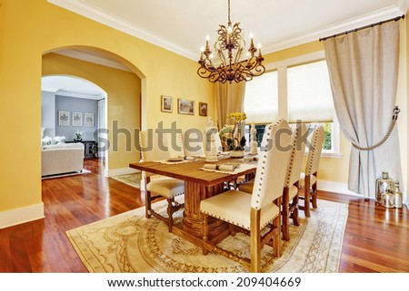 Bright luxury dining room with rich carved wood table