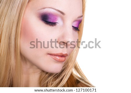 bright make-up of beautiful young blonde with eyes closed - stock photo