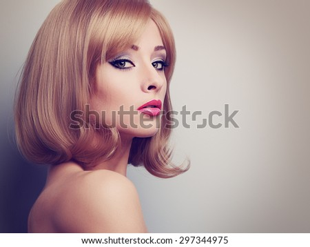 Bright makeup profile of beautiful woman with blond short hair looking calm. Closeup toned portrait with empty copy space - stock photo