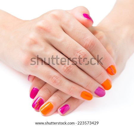 Bright manicure hands on white background