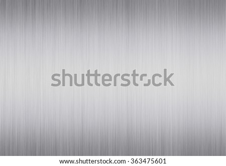 Bright metal texture neutral background with brushed chrome surface - stock photo