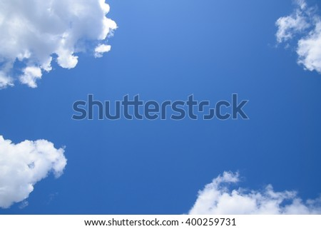 Bright midday blue sky with clouds. Heavenly landscape. - stock photo