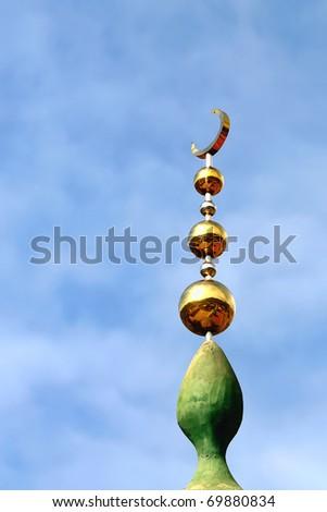 Bright minaret in the sky - stock photo