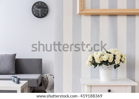 Bright, Modern Living Room With Roses In A Flowerpot On A White Table In The