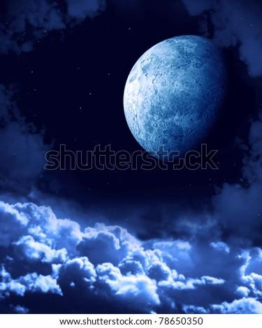 Bright moon in the night sky - stock photo