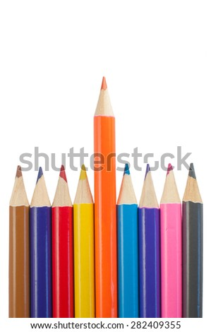 Bright multi-colored pencils in a row isolated on white. One pencil pushed forward. - stock photo
