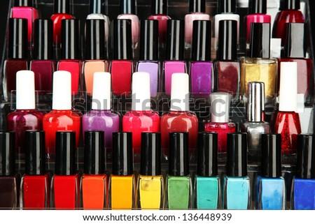 Bright nail polishes on shelf, close up - stock photo