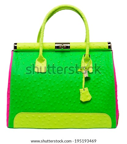 Bright neon green, pink and yellow bag with gold lock and ostrich texture leather isolated on white background - stock photo