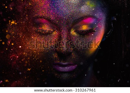 Bright neon make-up, creative body art on the theme of space and stars - stock photo