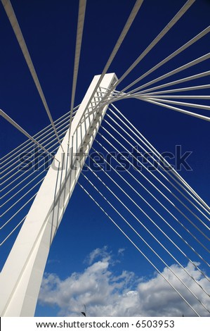 Bright new bridge with sky and clouds above.