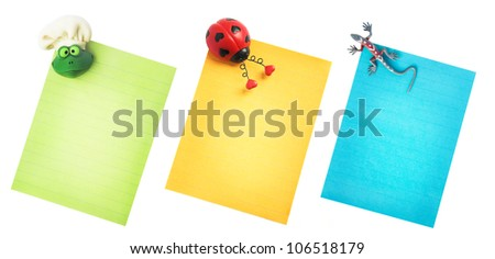 Bright notebook paper isolated on white with bug magnets