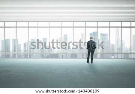 Bright office and businessman - stock photo