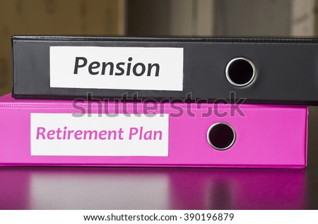 Bright office folders over dark background and retirement plan and pension text concept - stock photo