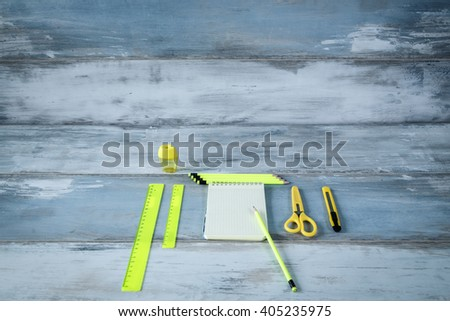 Bright office stationery on the wooden table vintage background close up