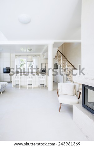 Bright open kitchen with living room - stock photo