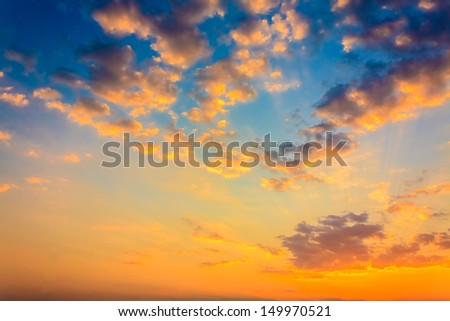 Bright orange and yellow colors sunset sky / Yellow blue sunrise sky with sunlight - stock photo