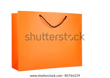 Bright orange paper shopping bag isolated on a white background. One black handle of the bag is visible. - stock photo